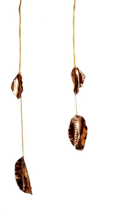 Copper leaves hanging from brass chiain with rhinestone chain accents