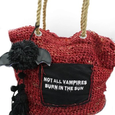 Red raffia north south tote with front pocket and bat pom pom.