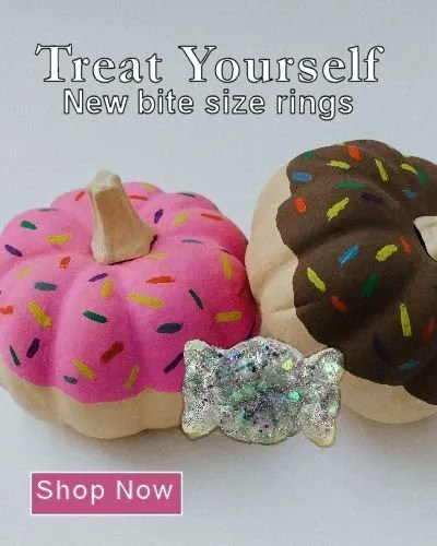 Donut icing style mini pumpkins on gray background featuring a ring