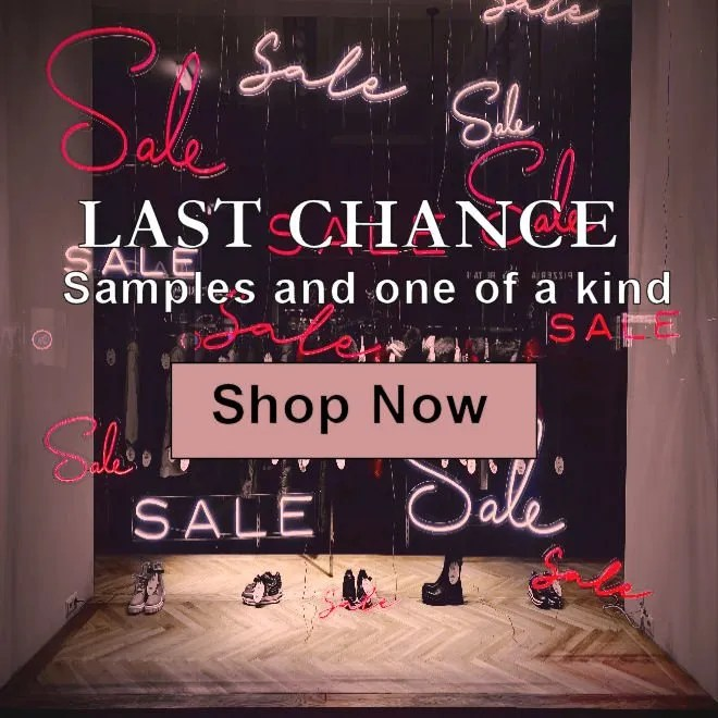 Sales window with a variety on neon lights spelling out sale