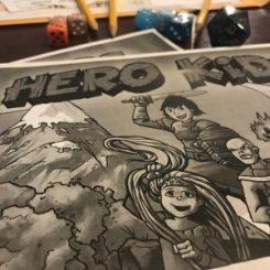 Dice, pencils, cover of Hero Kids RPG