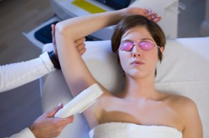 Lady receiving laser hair treatment