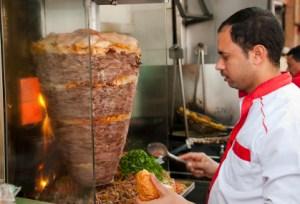 Worker serving Donner Kebab Sandwich