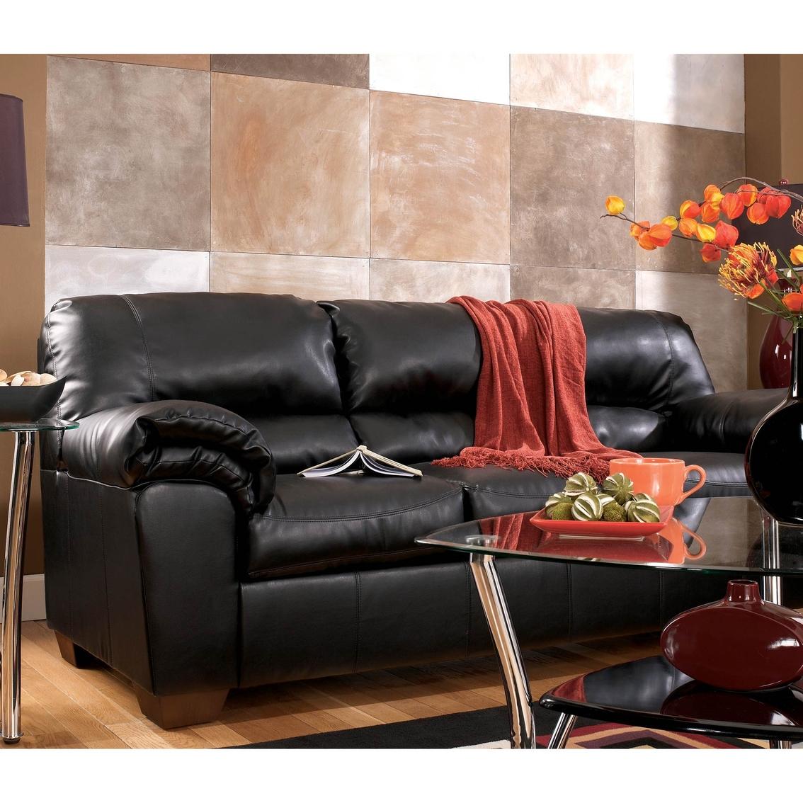 ashley furniture commando black sofa storage signature design by sofas and couches