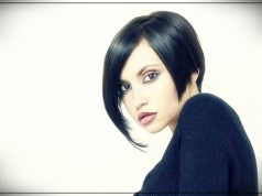 2. Dark Short Asymmetrical thin bob with bangs