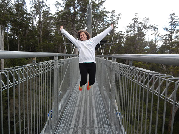 Chelsea jumping up on an extension bridge