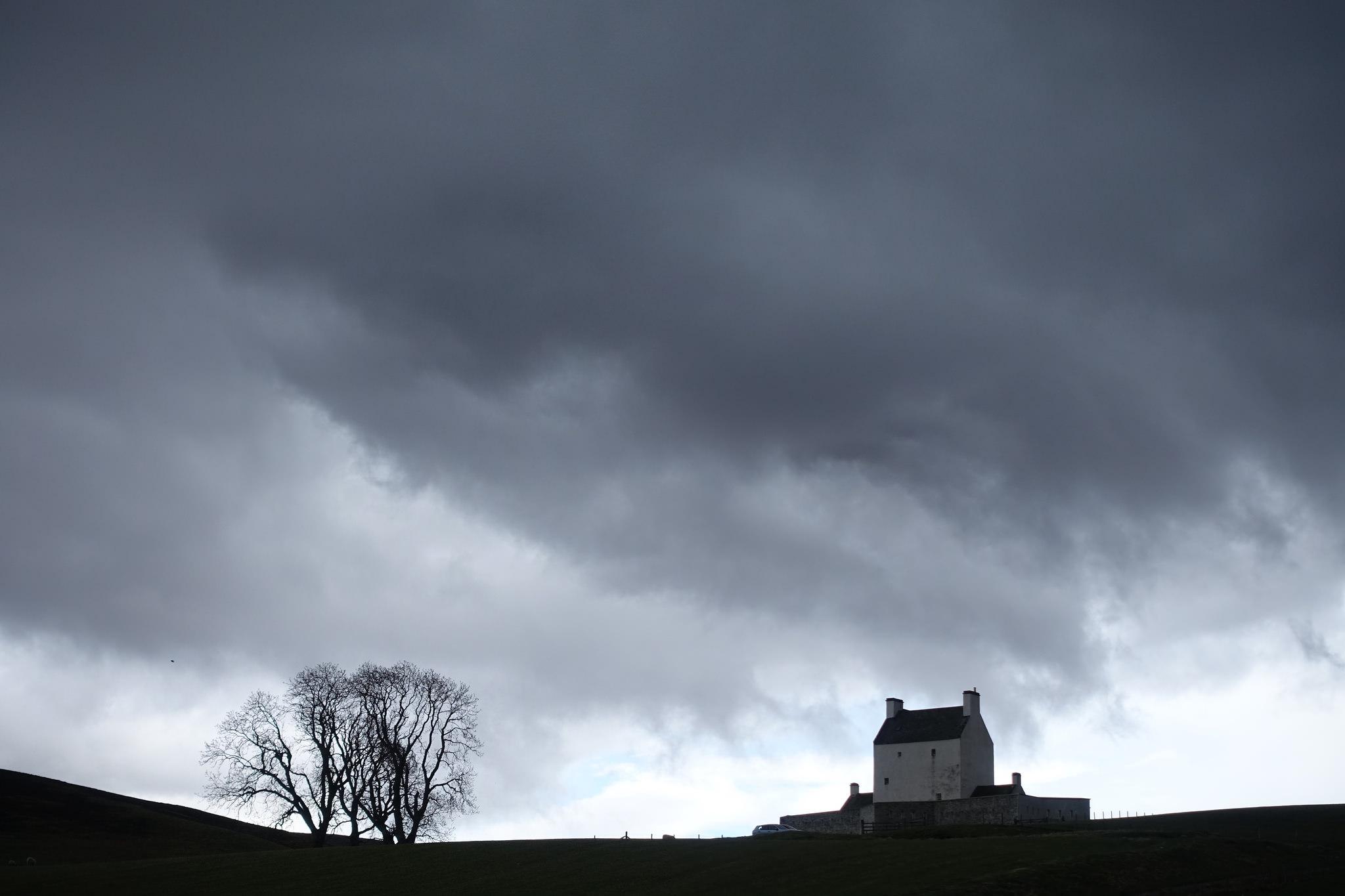 Corgarff Castle below ominous clouds