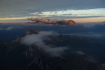 Looking toward the Sella group and Piz Boè at dawn, with clouds below
