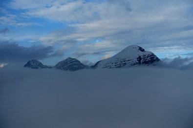 Three peaks of the Tofane peaking through the clouds