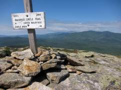 view from North Baldface, White Mountain National Forest, including a trail sign.
