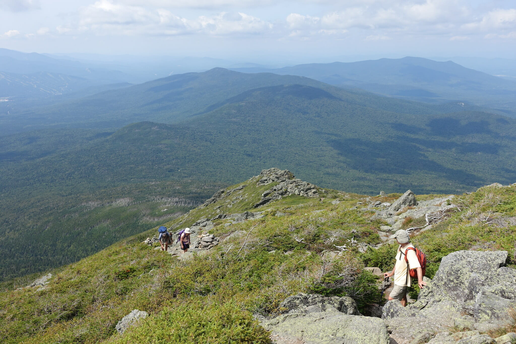 Three hikers on Ridge of the Caps Trail, Mount Jefferson