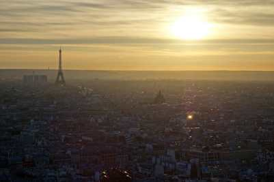 The roofs of Paris and the Eiffel tower glow at sunset from Sacré-Cœur