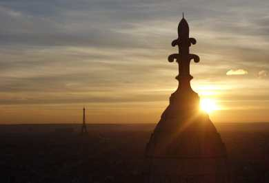 A spectacular sunset at Sacré-Cœur, with the Eiffel tower in the background