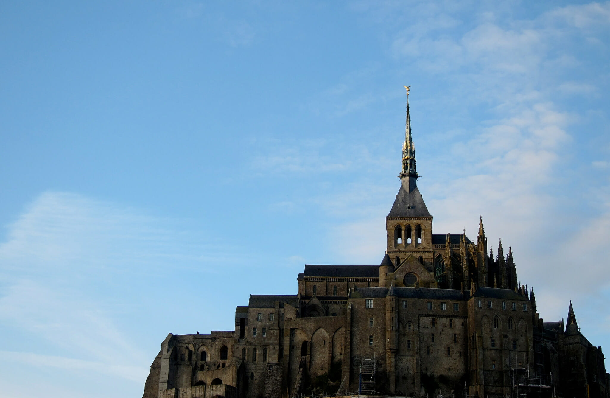 Mont Saint-Michel at golden hour on a clear winter day