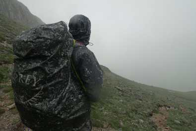 Kyle's pack (and pack cover) with a wet dusting of snow, long the trail.