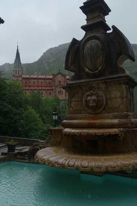 Fountain with Basilica of Santa María la Real de Covadonga in the background