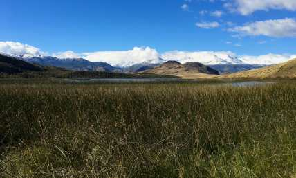Sunny skies return in Valle Chacabuco, with lingering clouds over the peaks in Reserva Nacional Lago Jeinimeni