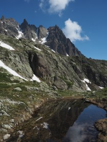 Smaller tarn and mountains at Lacs De Cheserys