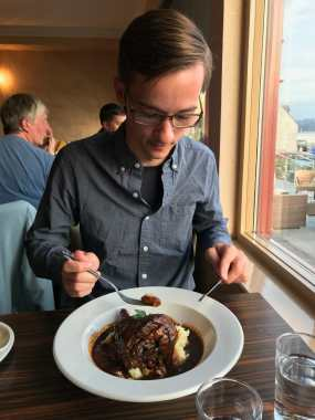 Kyle digs into his lamb shank at Myrtle Bank Hotel, Gairloch, Scotland