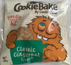 Orange monster with a rainbow eye holding a cookie