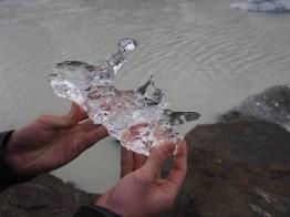 Kyle holding ice from Tasman Lake