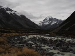Stream and Aoraki / Mount Cook unlearn overcast sky