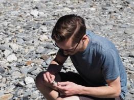 Looking at rocks at Fantail Falls