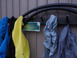 Hula Hoops hanging next to rain coats at Clinton Hut