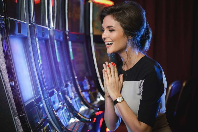 happy woman playing slot games