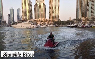 Akshay Kumar enters the press conference on a Jet Ski in Dubai.