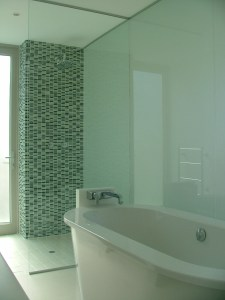 Frameless glass walk in shower floor to ceiling