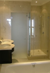 Frameless glass shower enclosure Cape Town with frosted glass toilet door