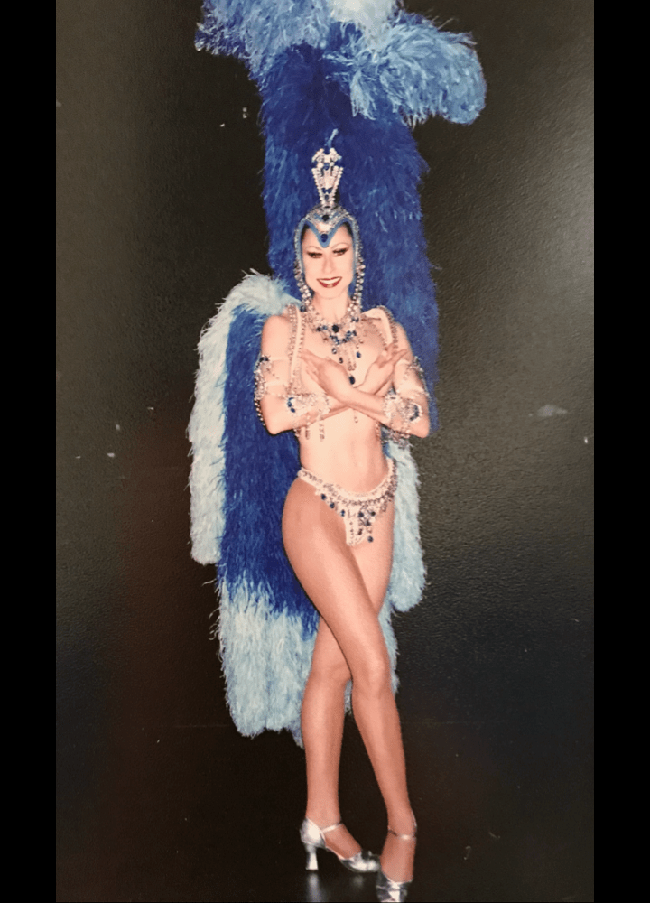 Las Vegas showgirl in blue and red feathered costume