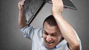 photodune 598494 angry businessman smashing his laptop s - Quer ganhar uma licença do TuneUp Utilities 2013?