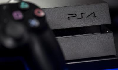 A logo sits on the front of a Sony PlayStation 4 (PS4) games console, manufactured by Sony Corp., in this arranged photograph taken in London, U.K., on Friday, Nov. 15, 2013. Sony, who released the PlayStation 4 game console today, is confident it can meet analysts' sales estimates of 3 million units by year-end, exploiting an early advantage over Microsoft Corp.'s Xbox One. Photographer: Simon Dawson/Bloomberg via Getty Images