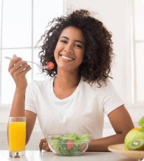 lady eating salad smiling curbs food cravings