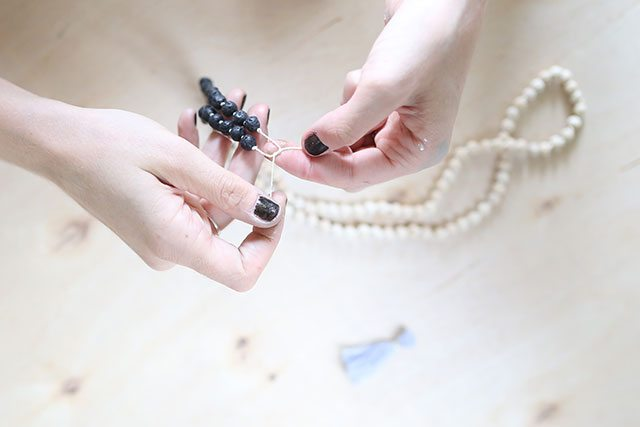 How-to-Tie-a-Mala-Wooden-Bead-Necklace---Tie-the-Ends-Together