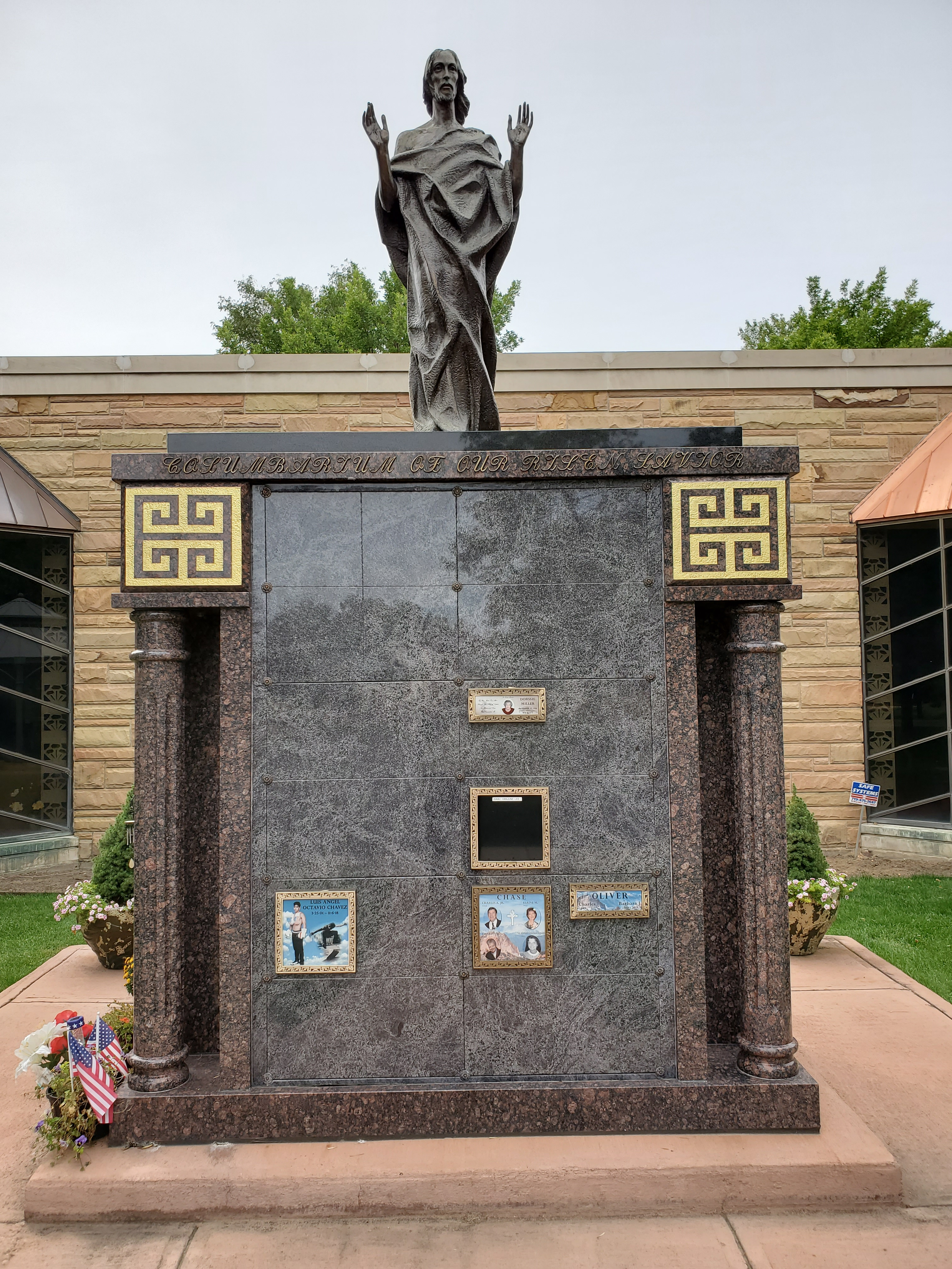 Our New Risen Savior Columbarium offering family estate niches weighing eleven tons with imported granite together with most impressive bronze Jesus statue Memorialization at its finest with state of the art bronze plaques for personalized photographs