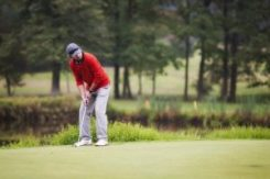 a golfer hitting the ball