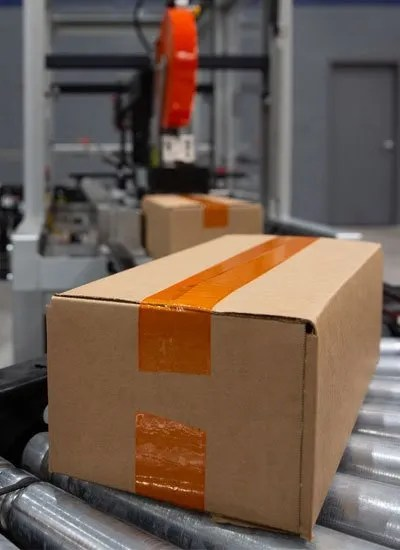 Orange HP 200 applied to a box on a packaging line