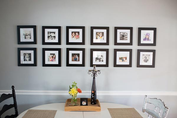 wall frames for living room sofa colors small 85 creative gallery ideas and photos 2019 shutterfly if you re looking a with uniform look check out this lovely display featuring two neat rows of in black
