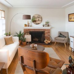 Decorating Ideas For Living Room With Brown Couch A Large Wall In 75 Enchanting Rooms Shutterfly We Love How Light And Bright This Feels The Wood Floor Dark Leather Armchair Are Perfectly Balanced By White Walls
