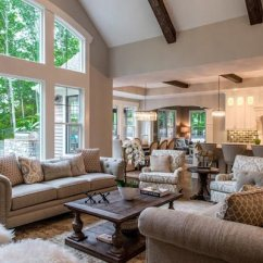Light Brown Sofa Living Room Ideas Sears Sofas 75 Enchanting Rooms Shutterfly This With High Ceilings Tall Windows And Beige Couches Feels Wonderfully Spacious