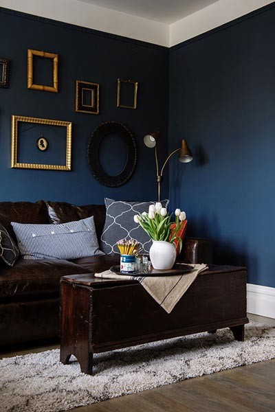 dark sofa in small living room mandaue foam bed 75 enchanting brown rooms shutterfly this smartly balances its blue walls and couch with white tulips gold frames