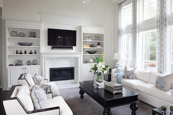 formal living room ideas with fireplace pictures contemporary 50 for 2019 shutterfly the blue decorative pillows and vases add perfect subtle pop of color to this black white