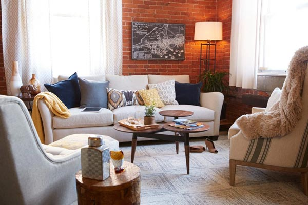 modern living rooms ideas images of with dark brown sofas 50 room for 2019 shutterfly an exposed brick wall is the cornerstone behind every industrial design
