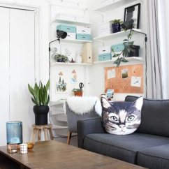 Simple Living Room Decor Pictures Console Table Ideas 50 For 2019 Shutterfly The Minimalistic Design On This Couch Allows Cute Cat Decorative Pillow To Be Star Of Show