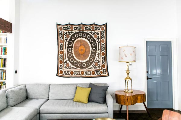 white wall decorations living room small color schemes 50 simple ideas for 2019 shutterfly a piece of patterned fabric is great decoration idea it will look perfect on any