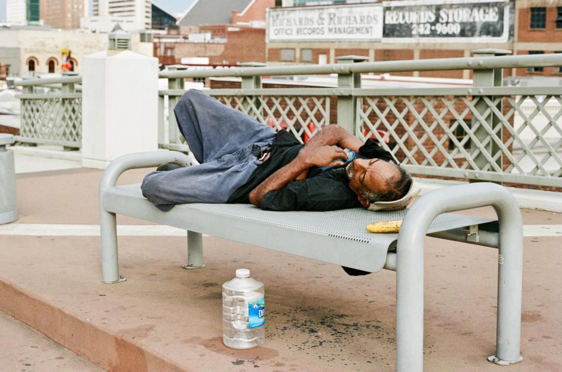 Homeless Man on Pedestrian Bridge