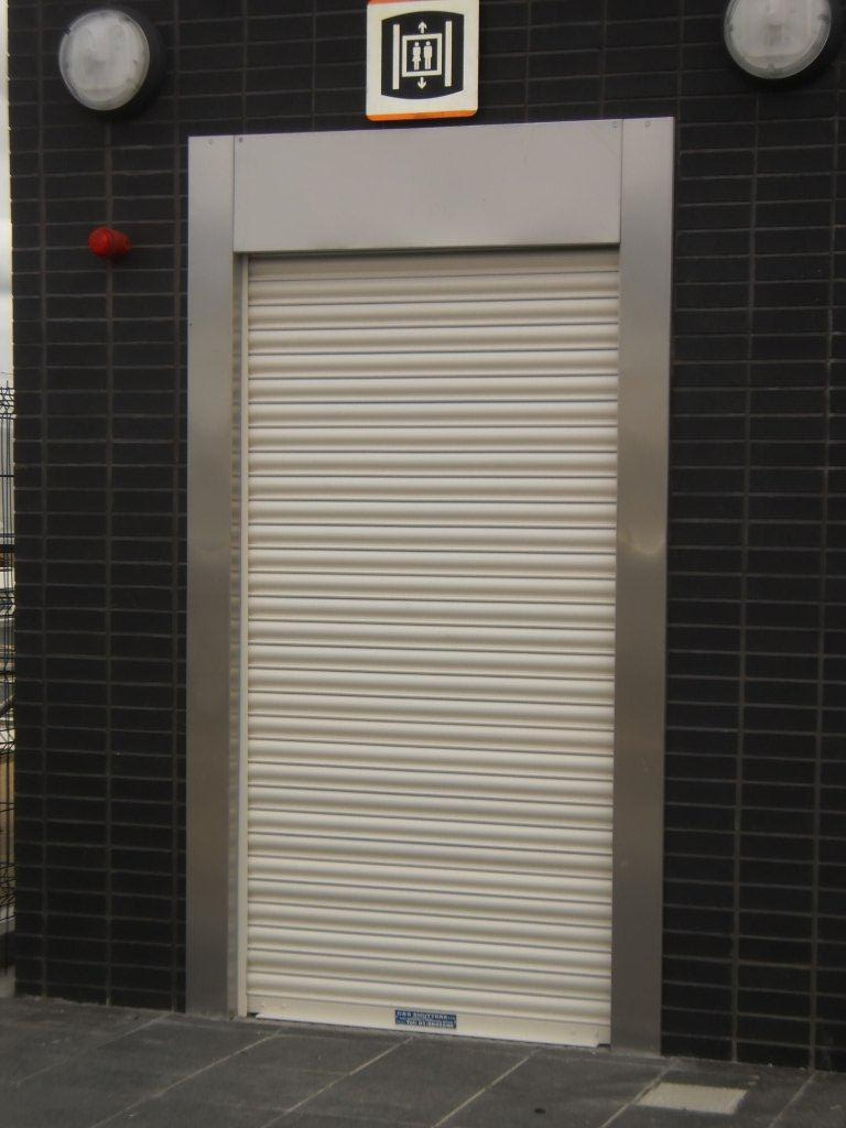 Fire shutter on lift shaft  CS Repair  Maintenance Ltd Roller Shutters and Doors